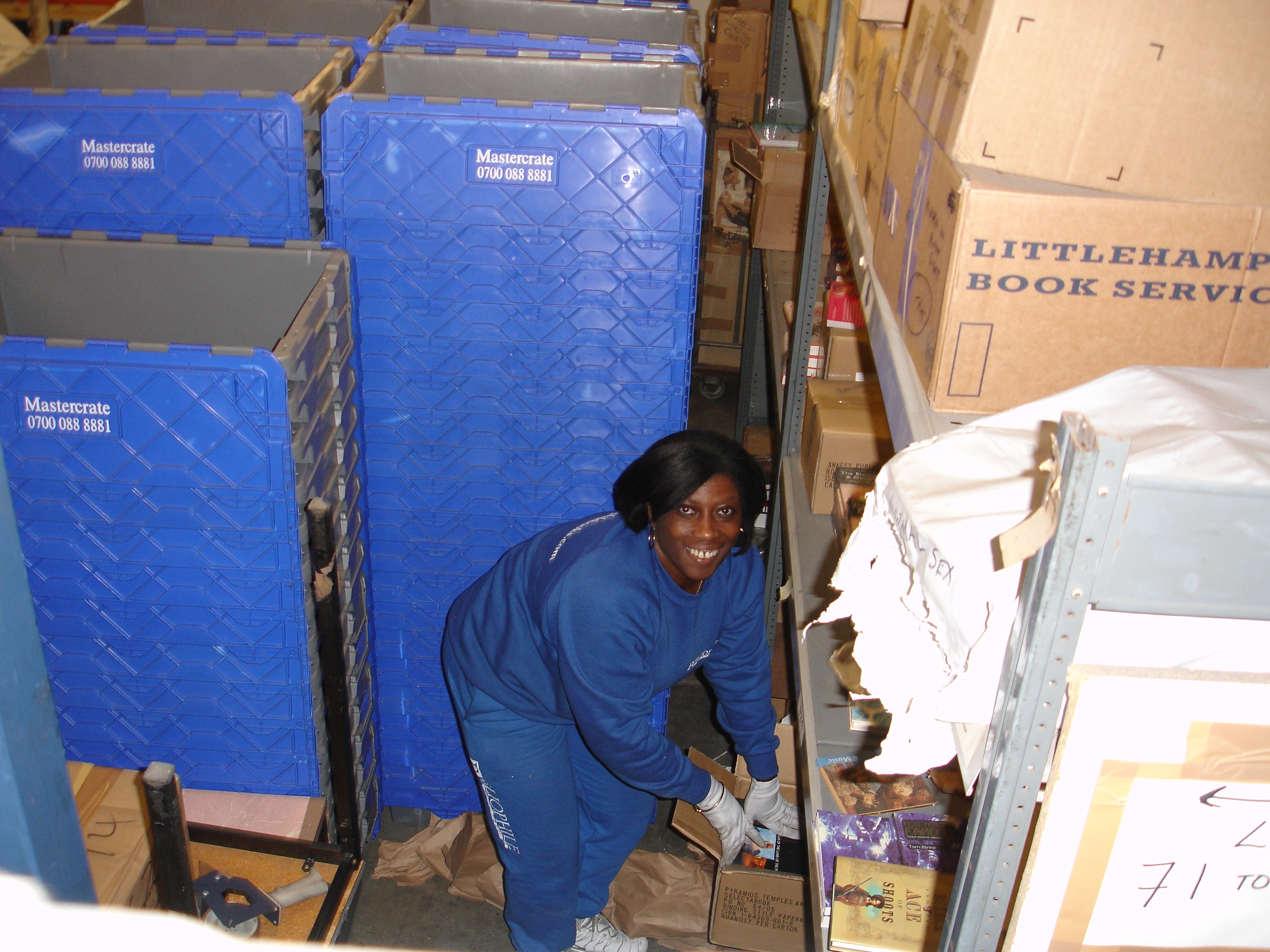 The lovely Wilma packs up for the huge warehouse move of 2009. We relocated to bigger premises and carefully wrapped nearly a quarter of a million books! / {Location}: Old warehouse 5 Thomas Road Poplar E14\\n\\n03/01/2008 15:23