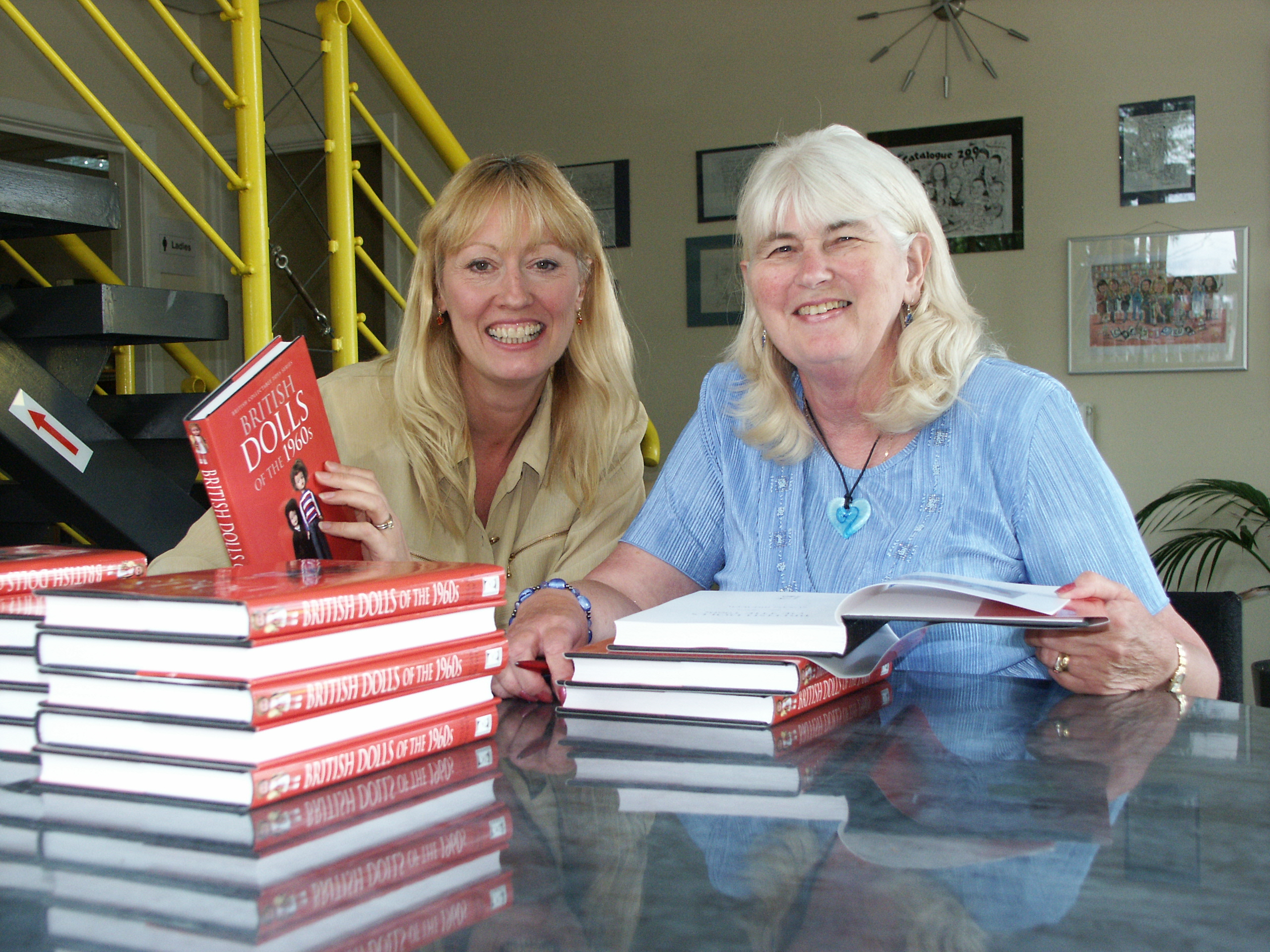 Sue Brewer and Annie 4th July 2012 signing \'British Dolls of the 1950s\', \'British Dolls of the 1960s\'. She is author of \'Collecting Classic Girl\'s Toys\', \'History of Girls\' Comics\', \'Classic Playground Games\' , \'British Dolls of the 1950s\', \'British Dolls of the 1960s\', \'Collecting Autographs\', \'Famous Character Dolls\', \'Tiny Tears and First Love; A Celebration of Two Classic Baby Dolls\', \'Mike\'s Bike\'. / {Location}: Bibliophile Datapoint\\n\\n05/07/2012 13:12